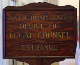 Sign at the entrance of the OLC office